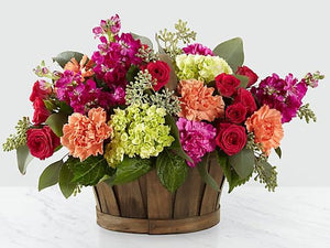 colorful flowers in basket delivered by florist in winnipeg