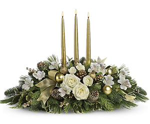 White Christmas arrangement with candles handcrafted by Valley Flowers, your florist in Winnipeg.