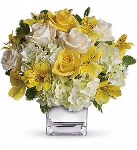 White flower with touches of yellow, created by local florist in Winnipeg.