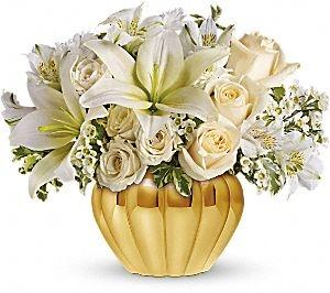 White flowers in metallic container. Tastefully arranged by local florist in Winnipeg-Valley Flowers