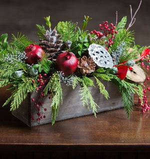 longlasting flowers for chrismas with winter greens and accents for delivery in winnipeg.