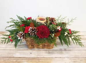 Christmas basket arrangement with candle hand crafted by winnipeg florist  Valley Flowers