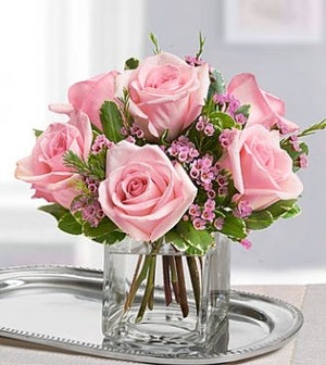 Pink roses in vase available for same day flower delivery in Winnipeg