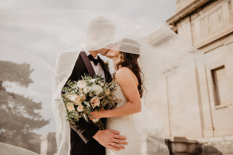Couple kissing with flowers in hand | Comfort Eats