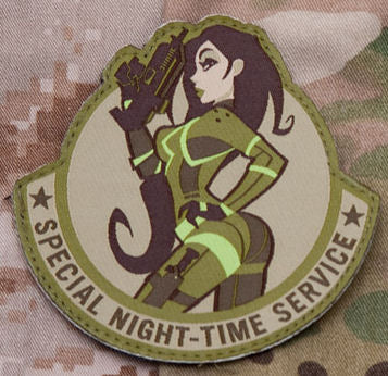 Some modern pinup action, to inspire those who take a more stealthy approach. This patch is done by the woven method to retain the original art detail