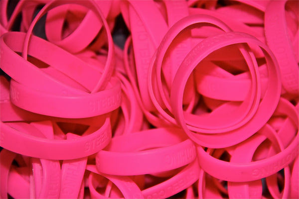 pile of steel clothing wristbands