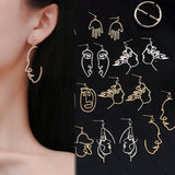 Retro Abstract Hollow Out Human Face Drop Earrings