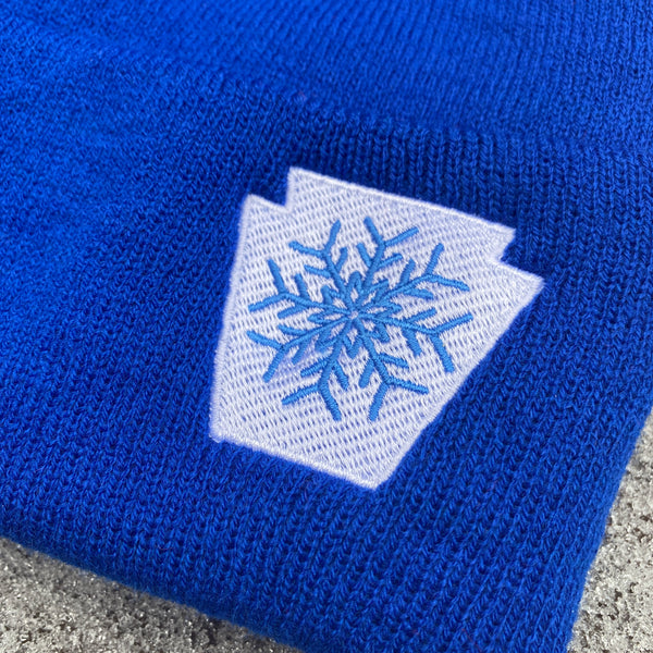 Snowflake Keystone Embroidered Cuffed Beanie