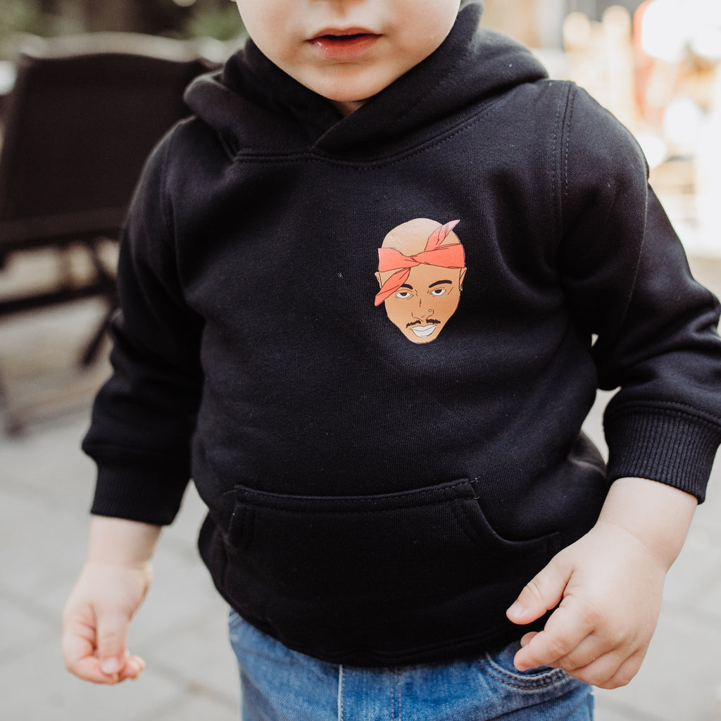 2pac hoodie in black owrn by small boy, face covered