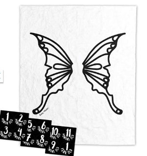 butterfly backdrop with the 12 black and white milestone cards laid out