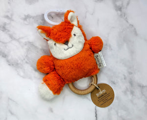 Orange fox soft toy teether flatlay on a marble background