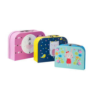 Set of three paper suitcases, largest pink with cartoon ballerina, medium is blue and yellow with cartoon owl and smallest is blue with cartoon animals and flowers