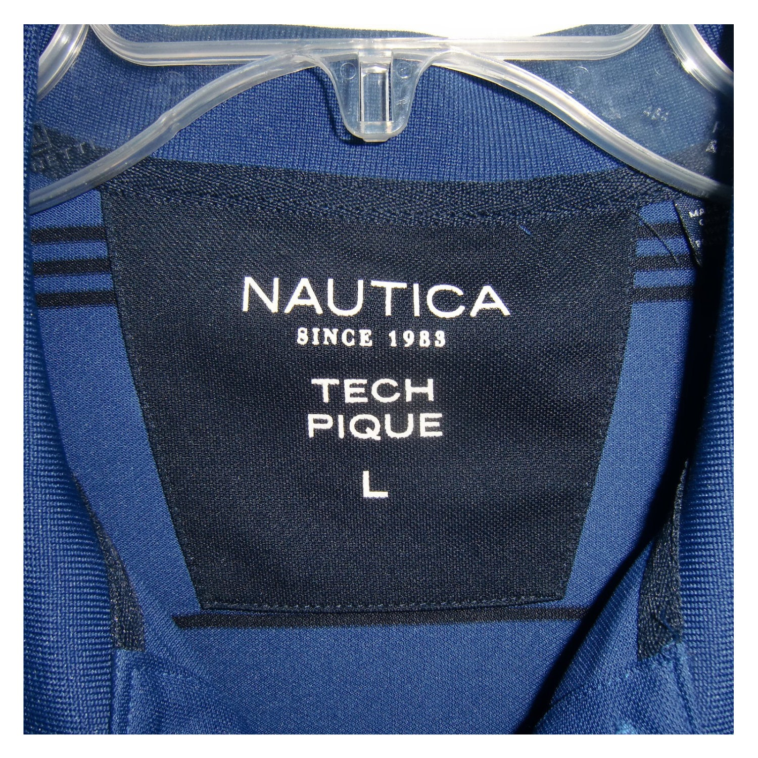 used Nautica man's blue polo shirt