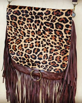 Hair on hide leopard flap crossbody handbag