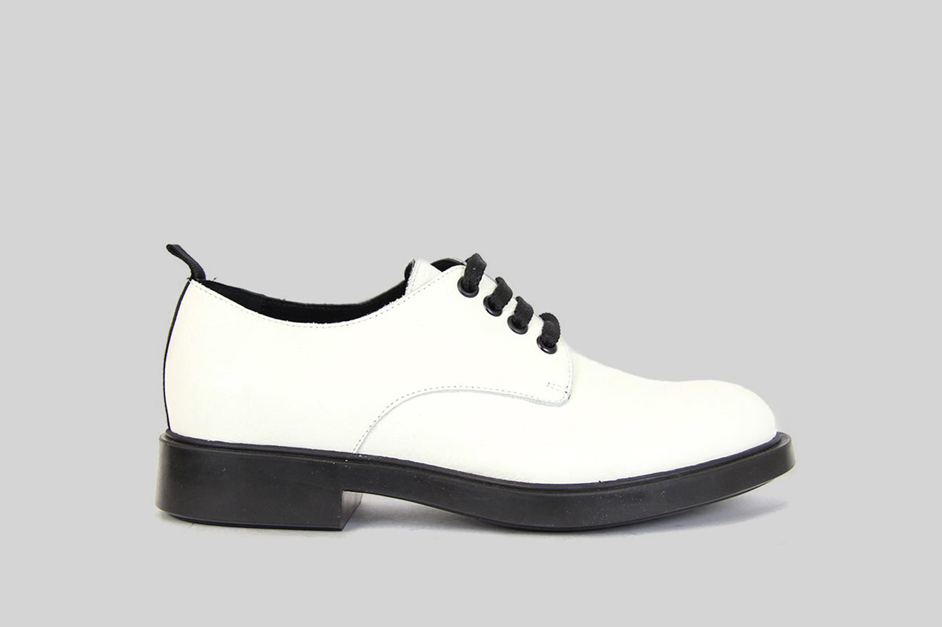 Women lace up shoes in white leather