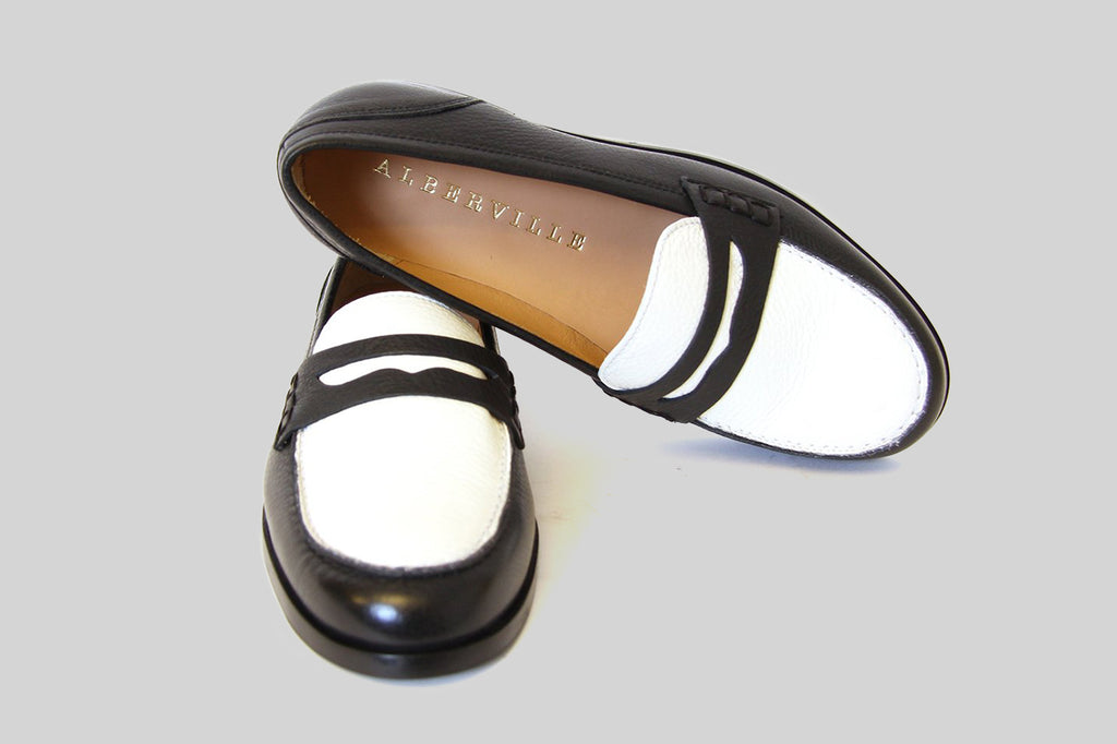 Women loafers in black and white leather