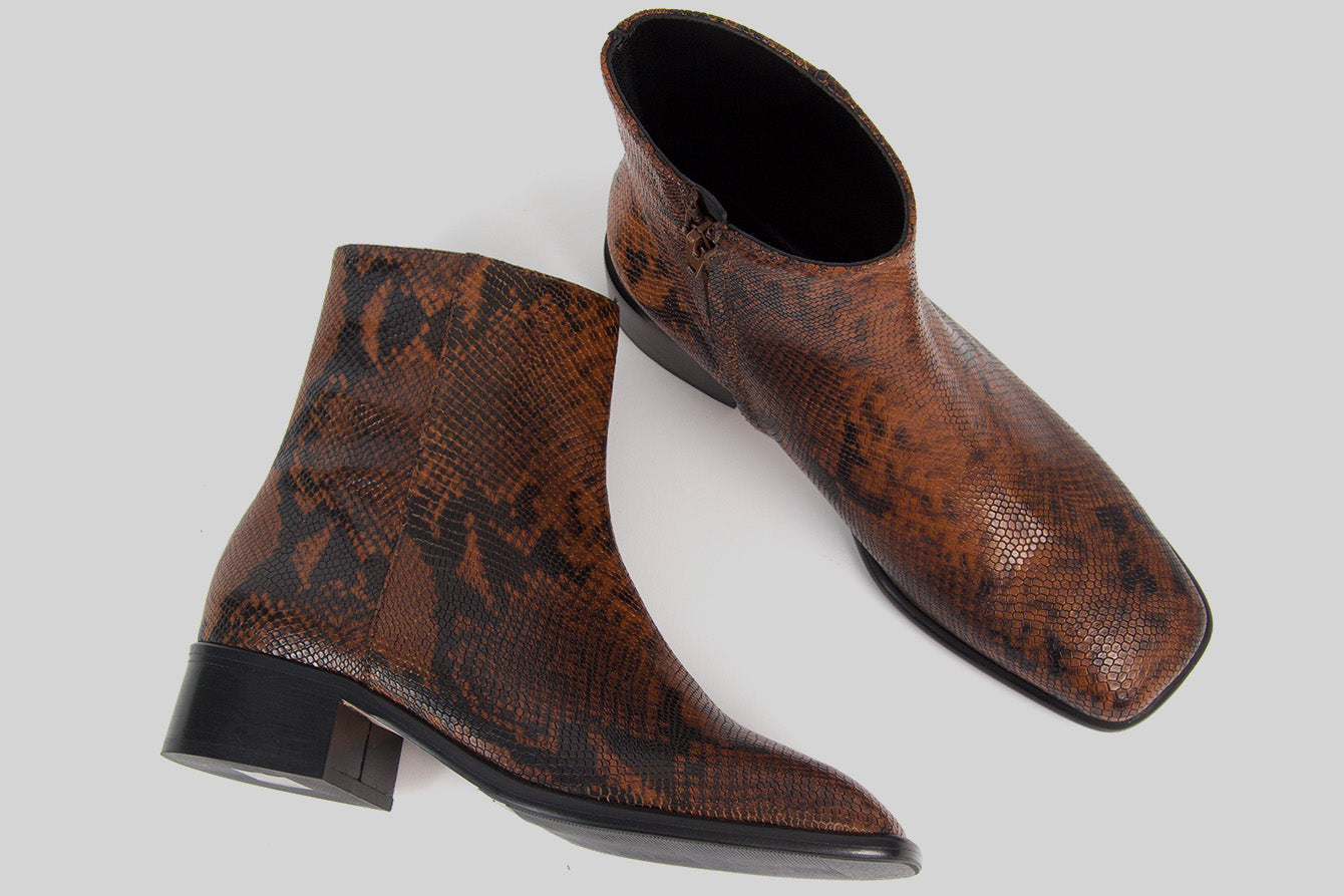 Women ankle boots in snake printed leather with a carré shaped toe