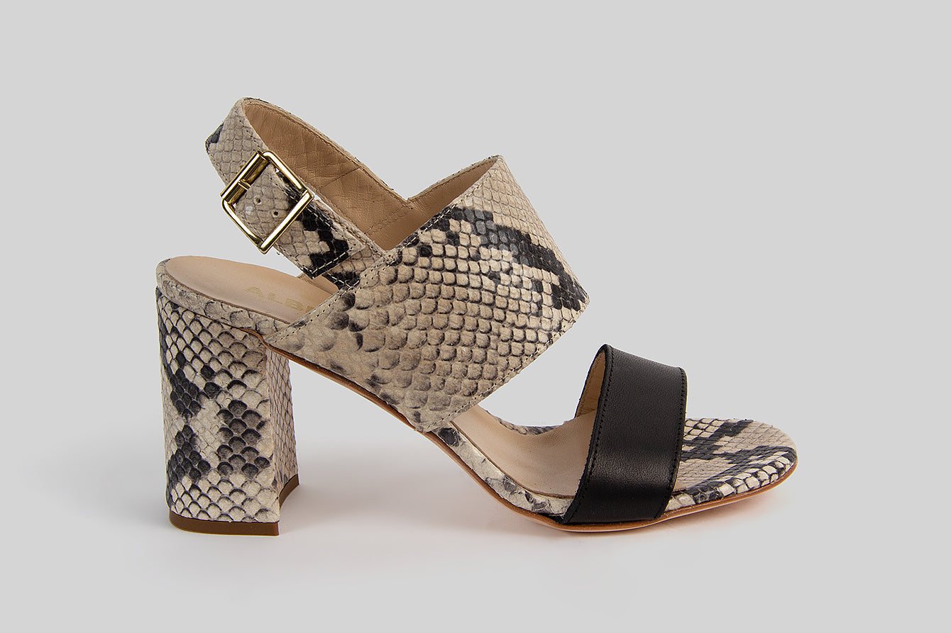 Open toe sandals on a heel made in black and snake printed leather