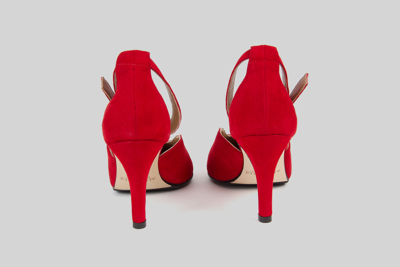 Two-piece pumps with a small ankle strap. Made in red suede