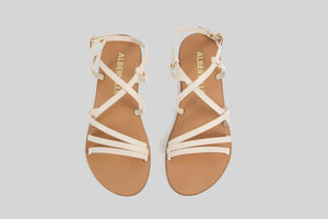 Beige sandal with thin straps.
