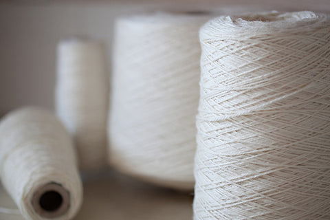 Undyed yarn on cones