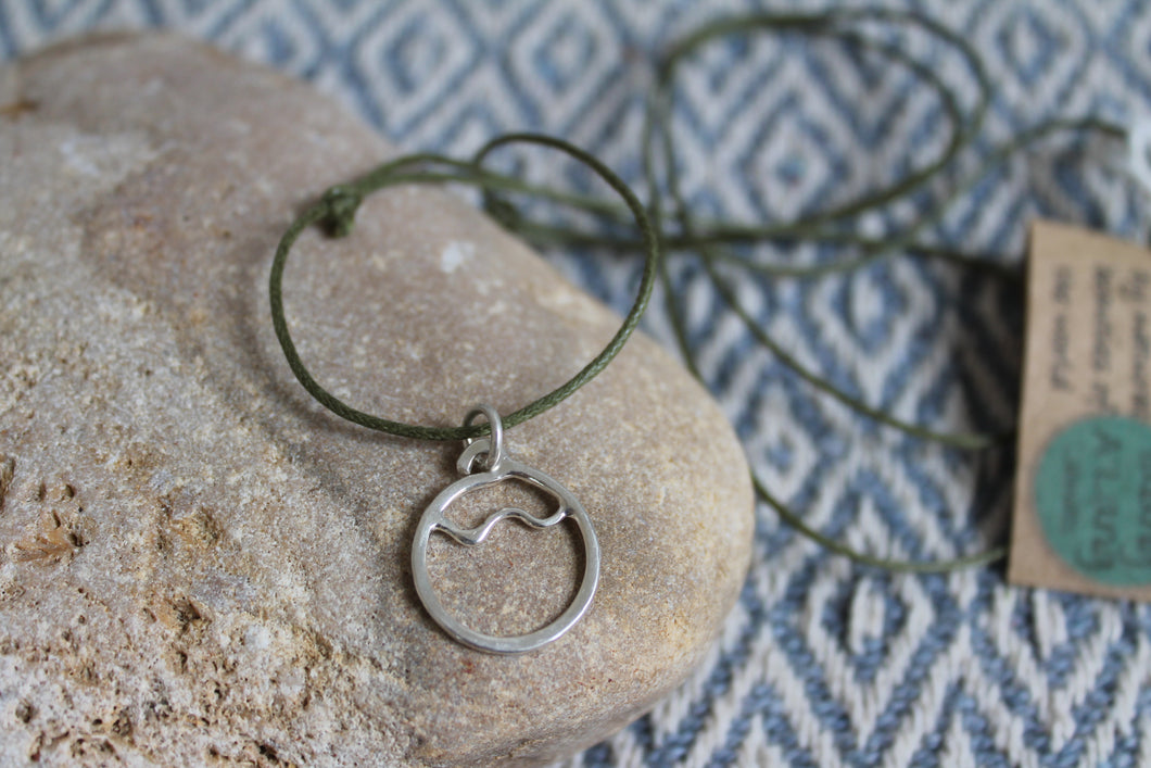 Flow necklace on green cord