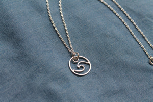 Small wave charm necklace on 40cm chain