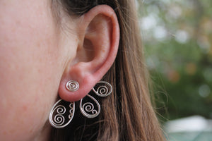 Swirling petal ear jacket earrings