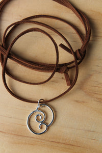 Meeting waves necklace on brown suede cord