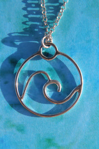 Swirled wave charm necklace