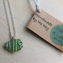 Load image into Gallery viewer, Green seaglass swirl necklace on your choice of cord or silver chain