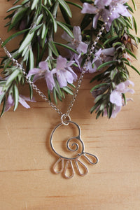 Spiralling petals necklace