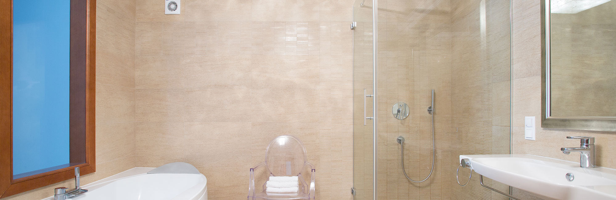 Glass shower enclosure and vanity mirrors