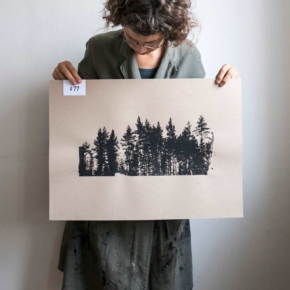Screen printed Finnish pines on brown paper.