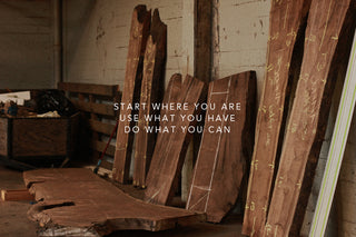 Timber in a Warehouse, marked for cutting. Overlaid with quote: Start where you are, use what you have, do what you can.