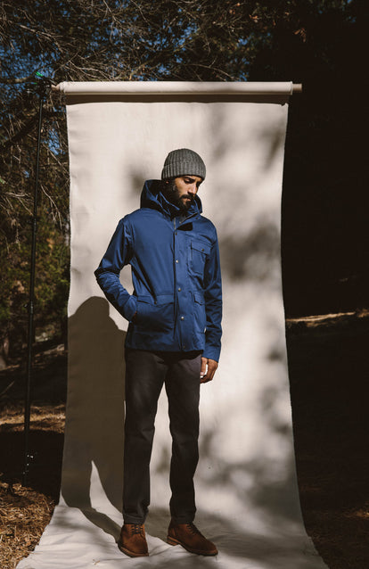 Modeling The Hawkins Jacket against a photographic screen setup outdoors, in front of some trees.