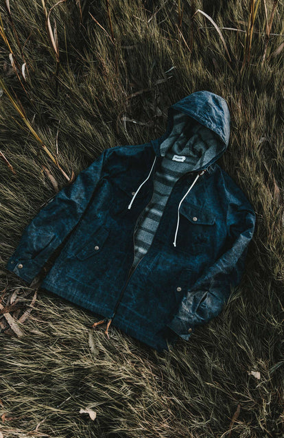 The Winslow Parka layed out flat on some long grass, shot from above.