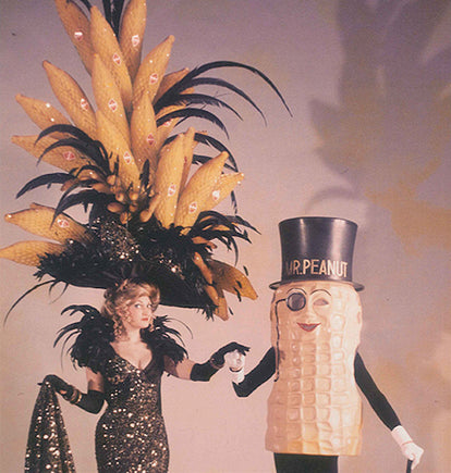 Mr. Peanut and a woman in an extravagant flapper outfit