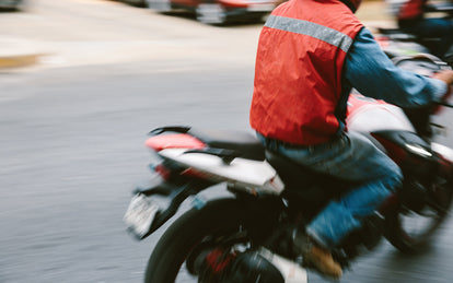 Blurred shot of a motorbike driving out of frame to the right.
