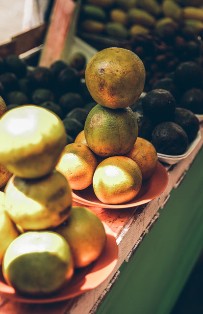 Fruits stacked up for sale on a market stall.