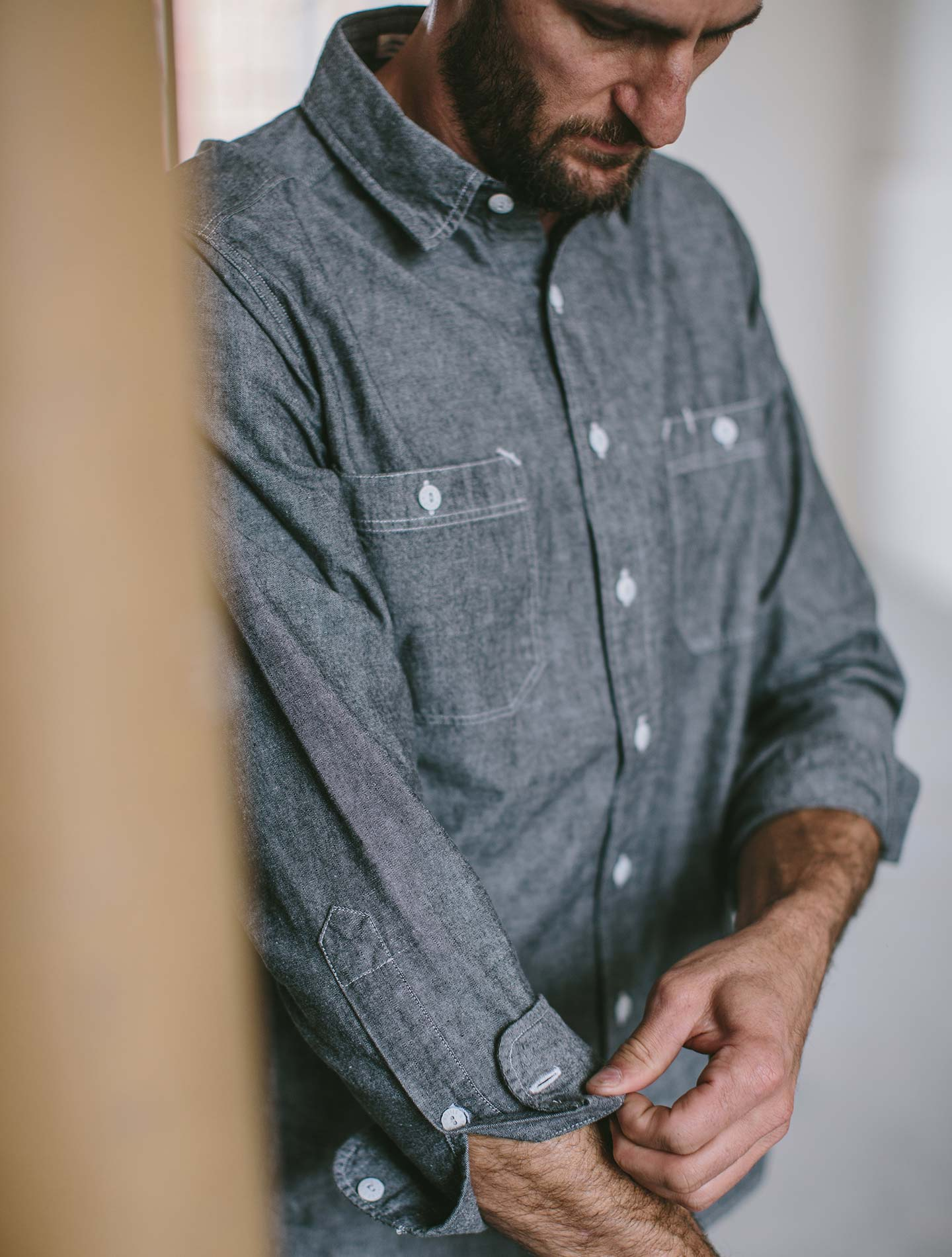 A man wearing a grey Chambray California.