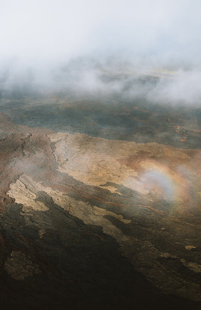 Abstract shot of sunlight reflecting and refracting on misty lava fields.