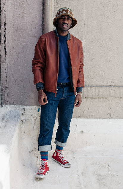 Modelling The Presidio Jacket, styled with red high-top Converse and rolled up jeans.