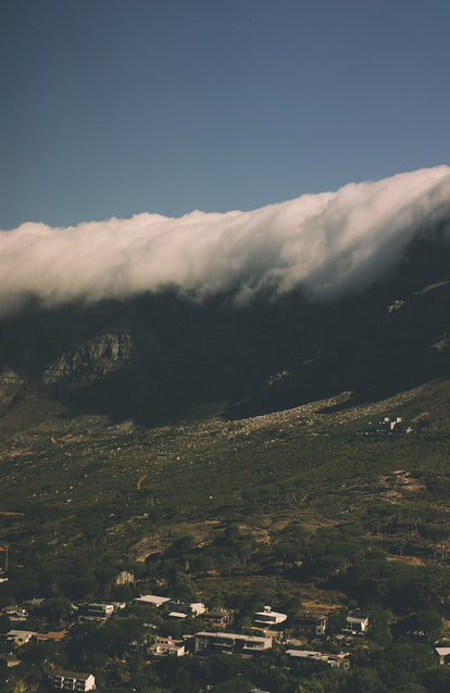Clouds spilling over the top and down the cliffs of Cape Town.