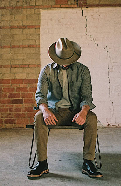 A man in a Texas warehouse wearing Taylor Stitch x Stetson.