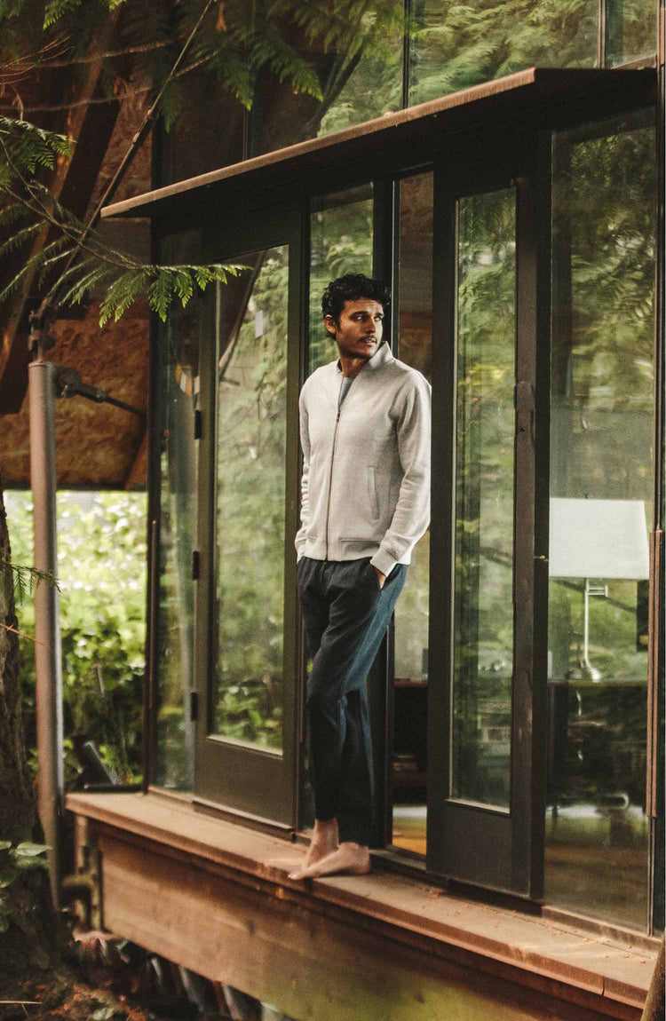 our fit model wearing the apres pant—standing near sliding glass
