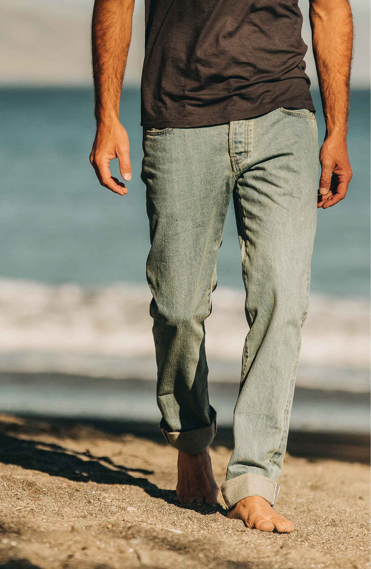 our fit model wearing the 24 month wash denim on the beach