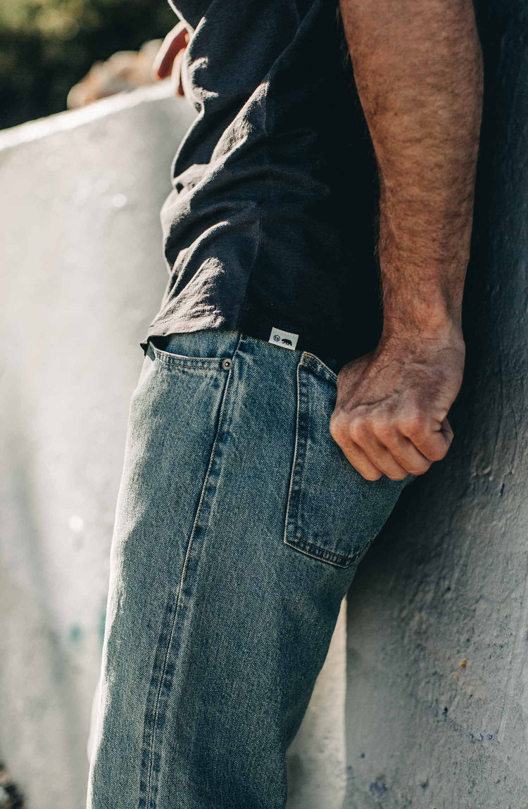 our fit model wearing the 24 month wash denim on the beach—cropped shot of pocket details