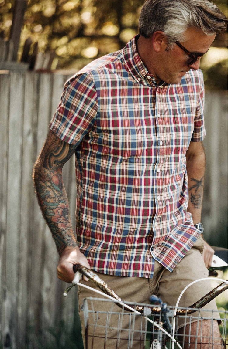 The Short Sleeve Jack in Red Madras — Model looking down while wearing shirt