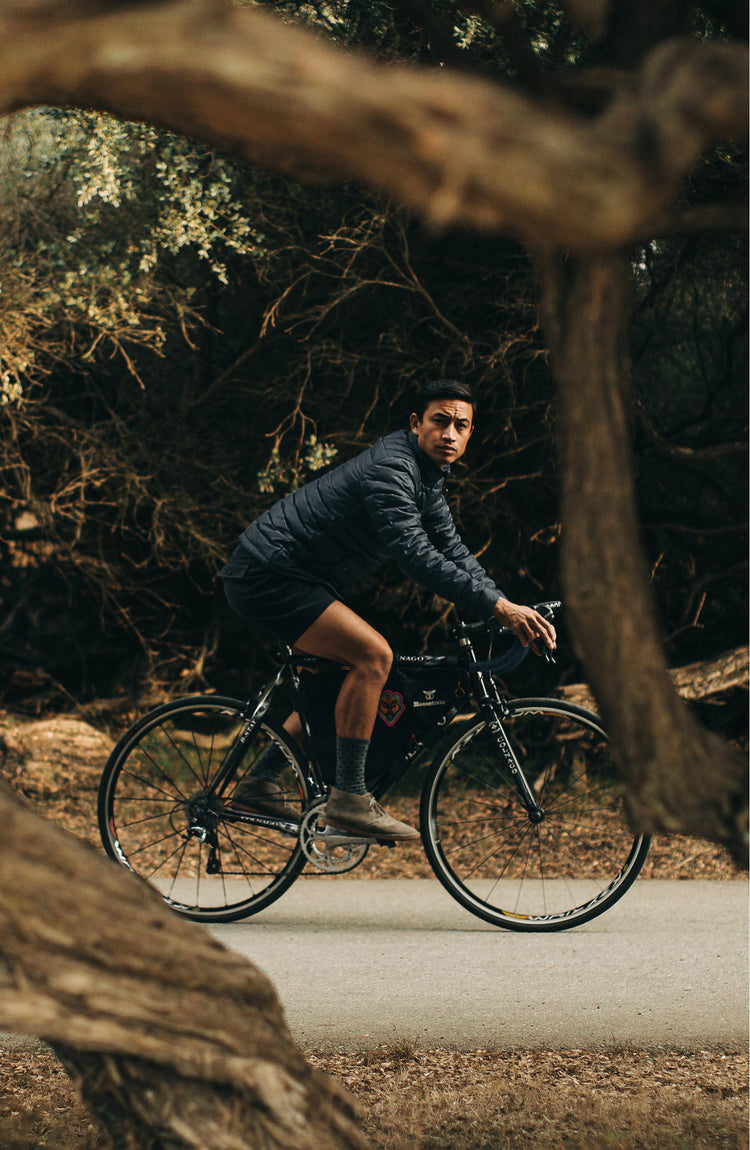 our model wearing the jacket with his bike